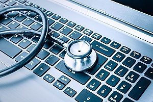 a stethoscope on top of a keyboard to represent antivirus or antimalware that comes with any good endpoint management strategy