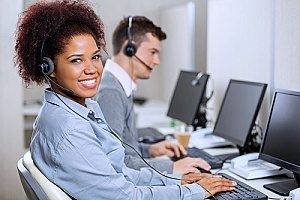 a customer service woman who is assisting clients using one of her cloud applications so that the clients can smoothly run their small business