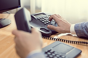 a business phone being used by an employee
