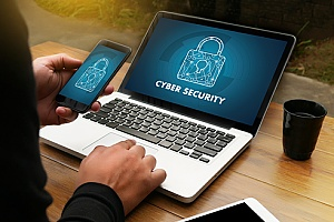 a business owner purchasing cybersecurity insurance