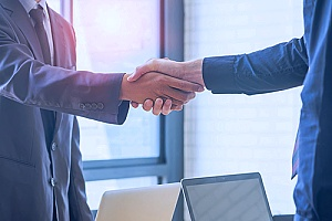 a handshake between a local business owner and an IT support partner