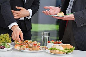 two businessmen enjoying lunch