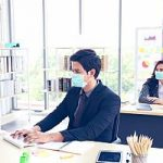 Employees returning to office in mask