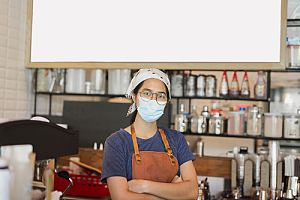 Small business owner with face mask