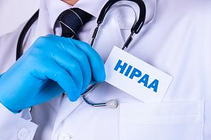 Healthcare worker putting HIPPA in pocket