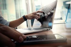 IT worker identifying phishing scam