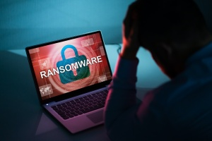man that looking at computer with a Ransomware attack