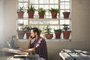 man looking up rules on Compliance Regulations For Your Small Business